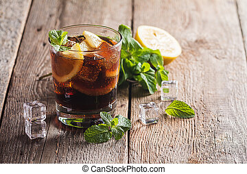 Fresh made Cuba Libre with brown rum, cola, mint and lemon...