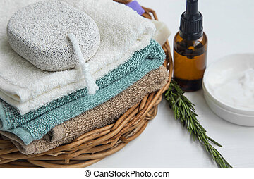 Spa setting with towels and organic skincare products