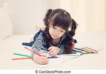 Asian kid drawing and do homework on the bed room, kid,...