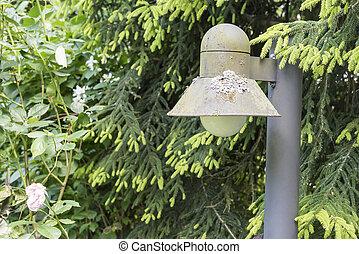 Closeup of a garden lantern at a sunny day