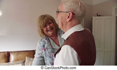 Senior Couple Dancing At Home - Senior couple are laughing...