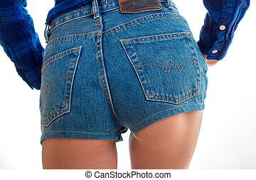 women's booty in denim shorts close-up isolated on white...