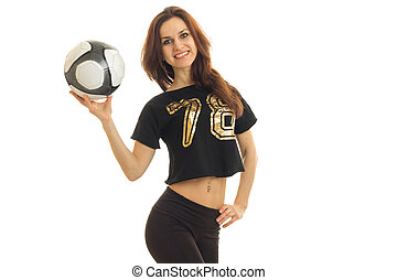 beautiful girl smiling in a sports suit, holding in her hand the ball