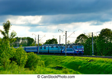 Electric train moves. Tilt shift. - Electric train moves on...