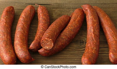 Fresh homemade sausages lying on wooden board