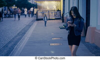 Girl with phone in hands