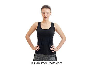 brunette sport girl in black unform looking at the camera -...