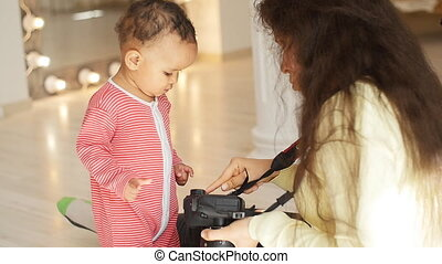 Baby looks at photos in photographer's camera - Cute Kid...