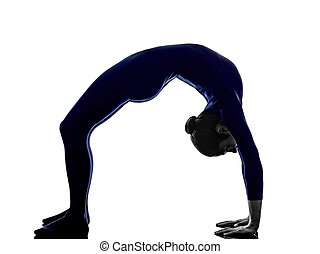 woman exercising Urdhva Dhanurasana bridge pose yoga silhouette