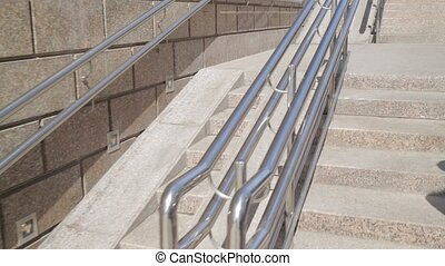 Showing in movement from below upward ramp for wheelchairs...