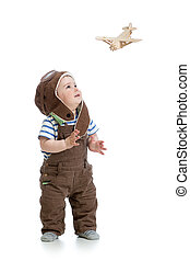 child boy playing with wooden plane isolated on white - Baby...
