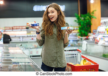 Shot of succesful choice between two products - Young woman...