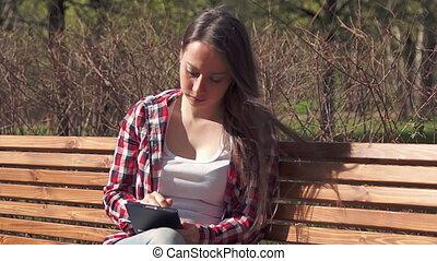 Cute brunette girl using digital tablet