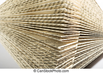 Close up on the corners of printed pages in a book folded...
