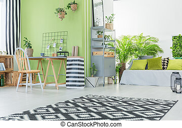 Modern room with green wall