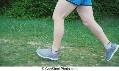 Feet of a running man - Legs of a man running on nature