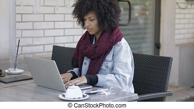 Beautiful female with pc in cafe - Beautifulblack woman with...