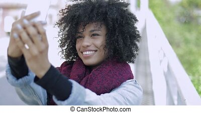 Young black woman taking selfie - Cheerful African woman in...