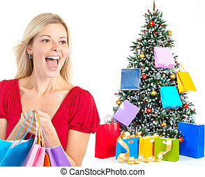 Shopping woman - Christmas shopping woman smiling. Isolated...