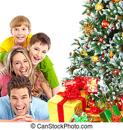 Family and Christmas Tree - Family and a Christmas Tree Over...