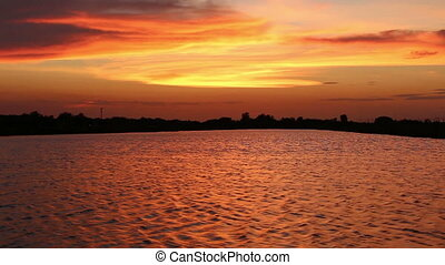 wave water under sunset