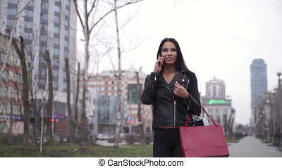 Woman talking on cellphone in the city.