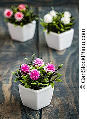 Artificial Flowers in White Flowerpots