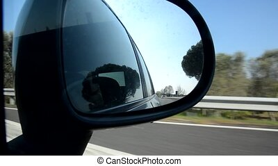The traffic on the Italian highway from the mirror