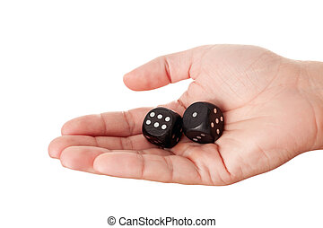 Hand holding two black dices
