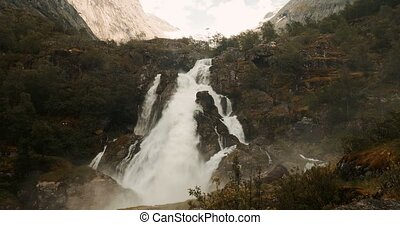 Kleivafossen Waterfall En-Route To Briksdal Glacier, Norway...