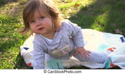 Little cute baby girl in the park