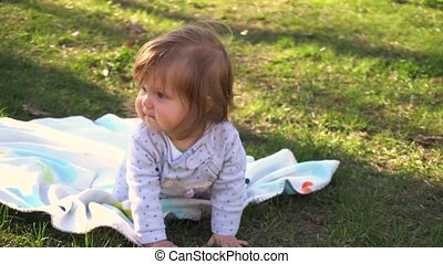 Little baby girl playing in the park