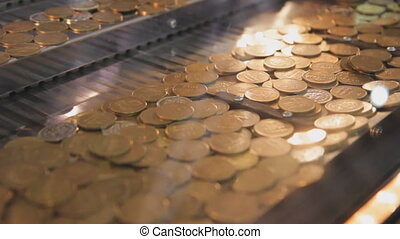 Arcade coin game. - Golden coins on the brink, in a...