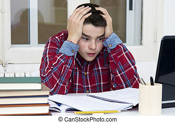 child tired and stressed at the school desk