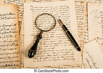 Fountain pen and magnifying glass on letter
