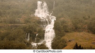 Waterfall In Briksdalsbreen Valley In Heavy Rain, Norway -...