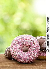 donut stacked and varied on the wood
