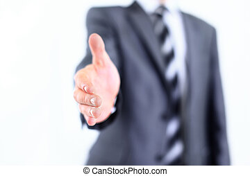 Portrait Of Young Businessman In A Suit Holds Out His Hand...
