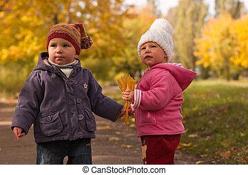 Children playing in autumn