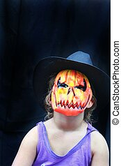 Halloween pumpkin head wearing hat