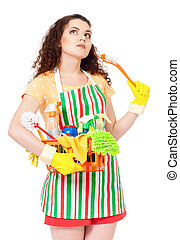Housewife with cleaning supplies - Tired young housewife...