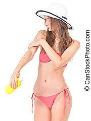 Girl posing in bikini - Female applying cosmetic cream for...
