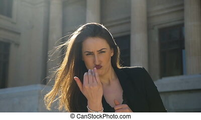 Closeup of young attractive woman provoking and punching in...
