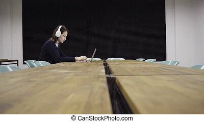 Woman working late on a laptop