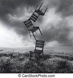 Moving Chairs - A surreal conceptual image representing...