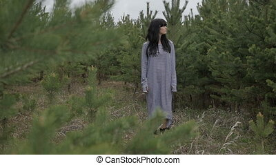 Woman standing in the woods