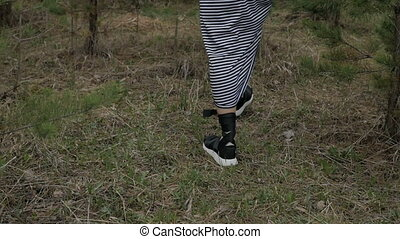 Unrecognizable woman in forest
