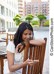 Outside texting - Closeup portrait, young happy business...