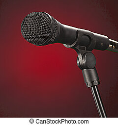 Microphone Isolated On Red Background