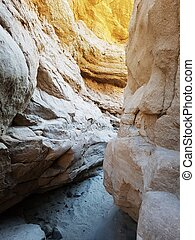 Light at the bottom of sand canyon walls - Sand canyon floor...